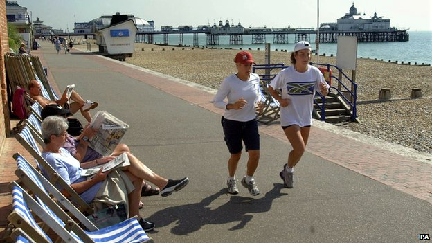 Arantxa Sanchez-Vicario jogging past people in deckchairs on Eastbourne seafront in 2001