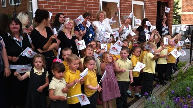 Pupils in Humberston welcome the baton