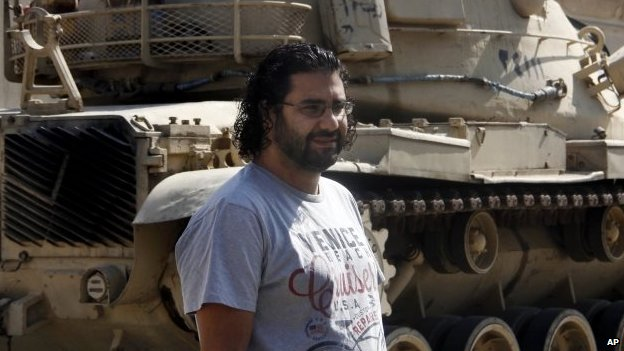 Prominent Egyptian blogger Alaa Abdul Fattah stands in front of a criminal court in Cairo, Egypt, 11 June 2014