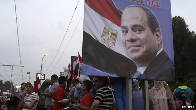 Egyptians celebrate after the swearing-in ceremony of President Abdel Fattah al-Sisi, in front of the Presidential Palace in Cairo, 8 June 2014