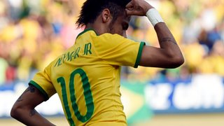 Neymar celebrates wearing the number 10 shirt