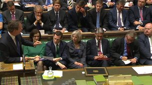 Michael Gove and Theresa May sit near each other