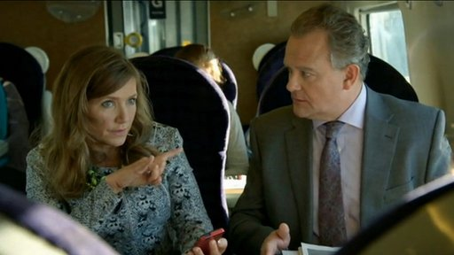 Siobhan Sharpe and Ian Fletcher from W1A on the train