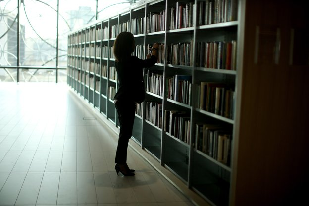 Woman browsing at library stack