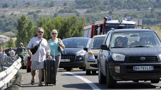 Passengers in Marignane near Marseille walk to the airport