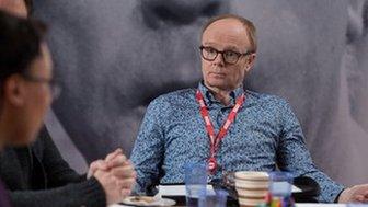 Jason Watkins as a BBC executive in a meeting