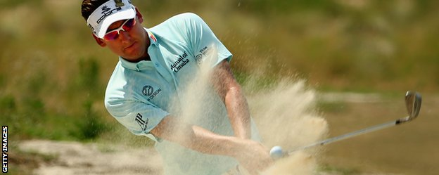 Ian Poulter plays out of a sandy lie during practice for the US Open