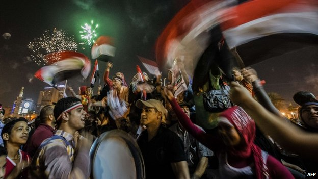 Egyptians celebrate in Cairo's on 3 June 2014