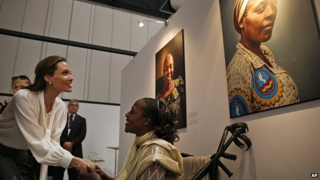 "Actress and UN envoy Angelina Jolie talks with Neema Namadamu of the Democratic Republic of Congo at the ""End Sexual Violence in Conflict"" summit in London, 11 June 2014"