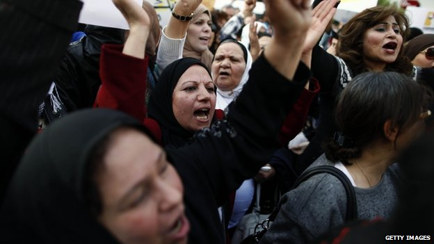 Egyptians chant slogans as they march in downtown Cairo to mark International Women's Day on 8 March 2013