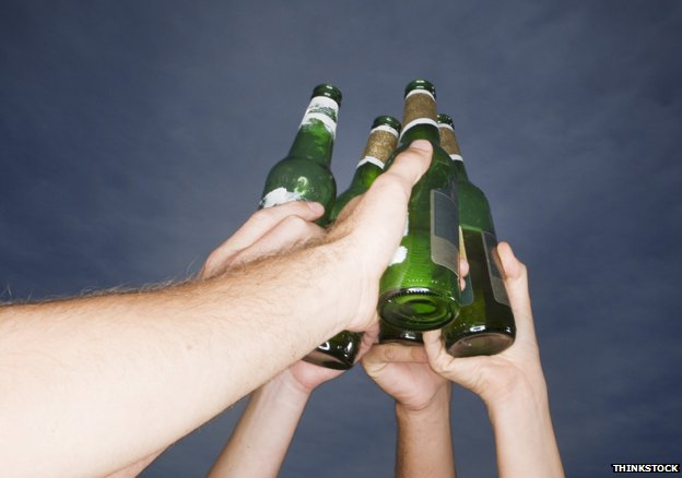 Friends toasting with beer bottles