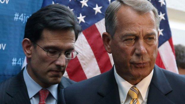 House Majority Leader Eric Cantor stands next to Speaker of the House John Boehner.