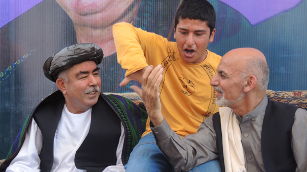 Ghani (right) with Dostam and a young boy
