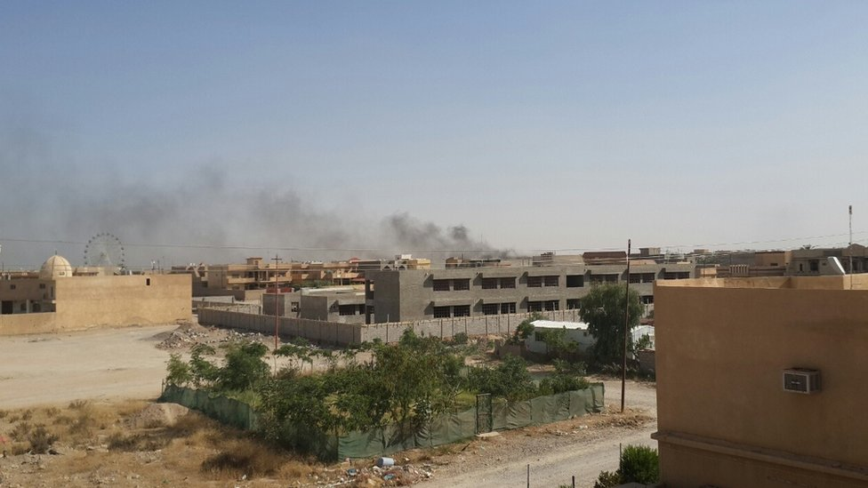 Smoke rises over the city of Tikrit