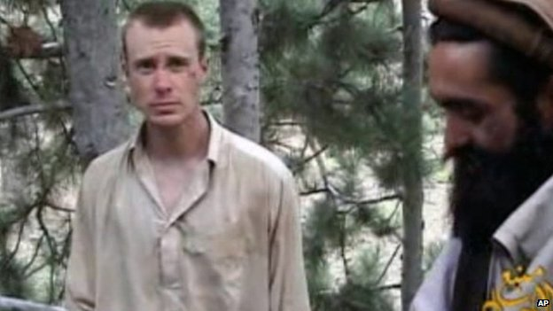 This file image provided by IntelCenter  shows a frame grab from a video released by the Taliban containing footage of a man believed to be Bowe Bergdahl, left. 8 December 2010