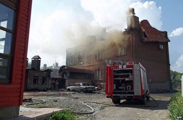A fire engine fights a blaze in Sloviansk, 8 June