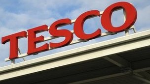 A Tesco sign on a supermarket roof