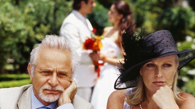 An unhappy couple attends a wedding