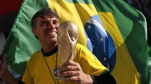 Brazil fan World Cup trophy and flag
