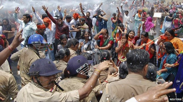 Police use a water cannon to stop crowds  from moving towards the office of Yadav, chief minister of Uttar Pradesh, during a protest against recent rape and hanging of two girls, in Lucknow