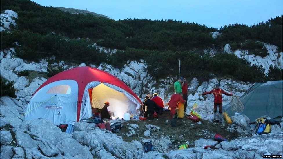 Rescuers at a tent camp near the cave's entrance