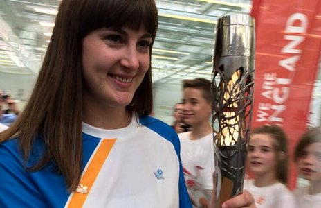 Laura Beardsmore carrying Queen's baton