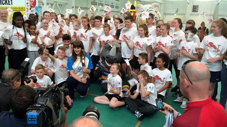 Children at headingley with the Queen's baton
