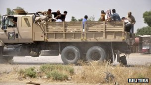 Iraqi security forces leave a military base as Kurdish forces take over control in Kirkuk, 11 June 2014
