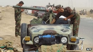 Kurdish Iraqi peshmerga forces deploy their troops and armoured vehicles on the outskirts of Kirkuk, 12 June 2014
