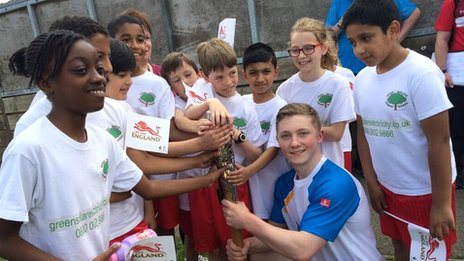Nile Wilson holds Queen's baton in Leeds