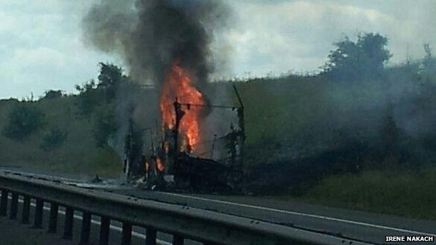 Double decker bus on fire on M11