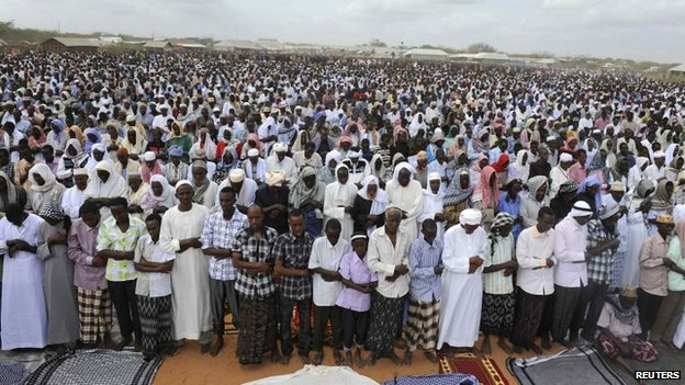 Somali refugees pray during celebrations of the Eid al-Fitr in the Ifo marketplace in Kenya's Dadaab refugee camp - 2011