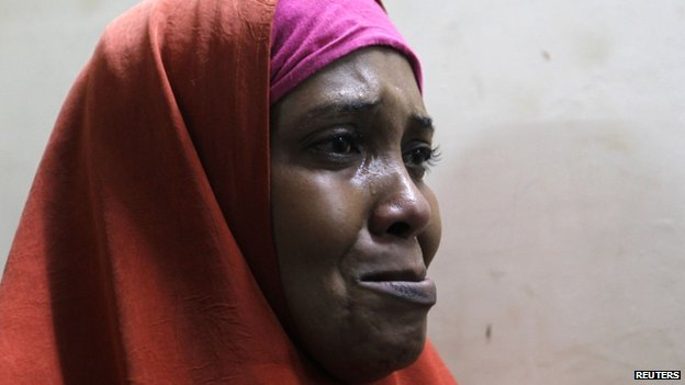 A suspected Somali illegal migrant arrested in a police swoop cries as she prepares to be processed for deportation at a holding station in Kenya's capital, Nairobi, 9 April 2014
