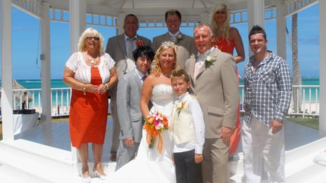 The couple and guests at their wedding