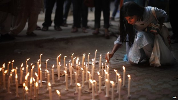 A candle lit vigil in Delhi on May 31, 2014 to protest against the gang rape of two teenage girls