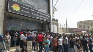 Iraqi troops queueing outside Iraqi Airways