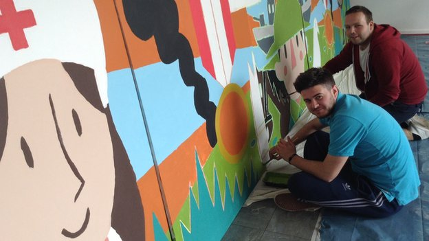 Lieam Williams and Ifan Hughes work on the Ysgol Glancegin war mural