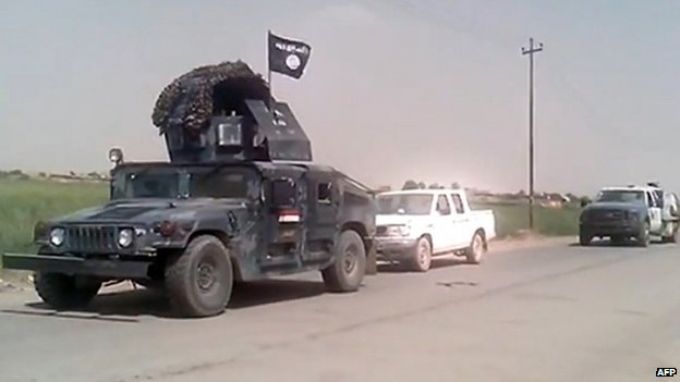 Still allegedly showing an Iraqi army vehicle with a Jihadist flag in Mosul (12 June 2014)
