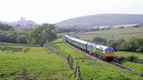 A Class 33 D6515 locomotive train