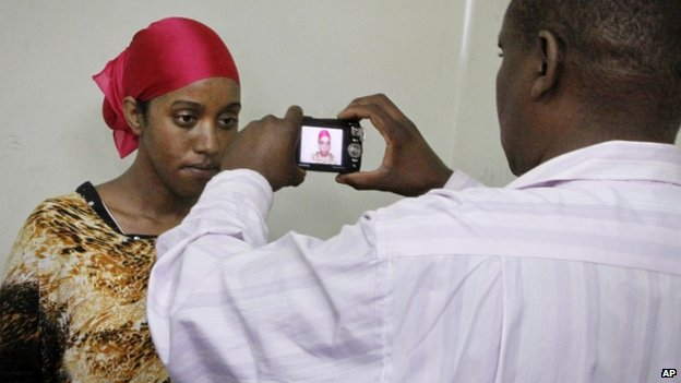 A detained Somali woman has her photograph taken before being fingerprinted and screened at the Kasarani sports stadium - 9 April 2014