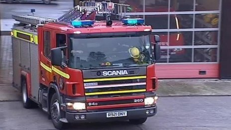 Fire engine leaving a station in west Wales