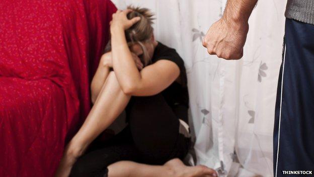 Woman cowering