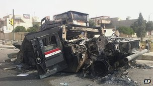Burnt out vehicle in Mosul
