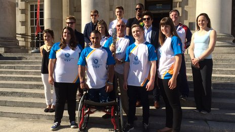 Sports volunteer and ex-rugby player Norman Stephens carried the baton outside the Civic Hall