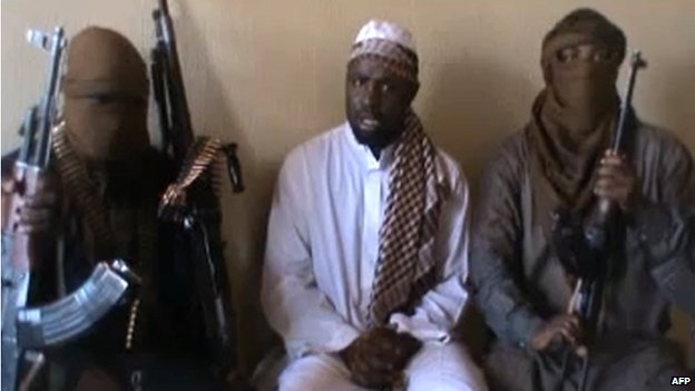 A screengrab taken from a video released on YouTube on 12 April 2012 with Boko Haram leader Abubakar Shekau (C) sitting flanked by militants
