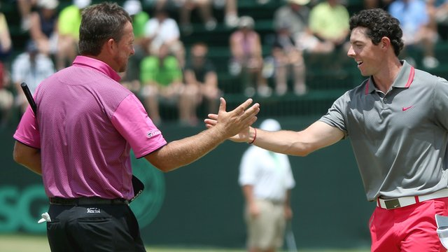 Graeme McDowell shakes hands with Rory McIlroy at the end of their first round
