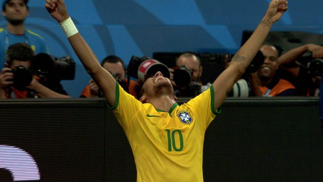 Brazil striker Neymar celebrates scoring Brazil's second goal