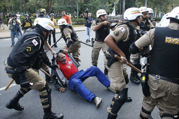 Riot police detain a man during a protest against the World Cup in Belo Horizonte - 12 June 2014