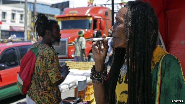 A demonstrator smokes marijuana during a march in Kingston for the legalisation of the plant. 21/04/2014