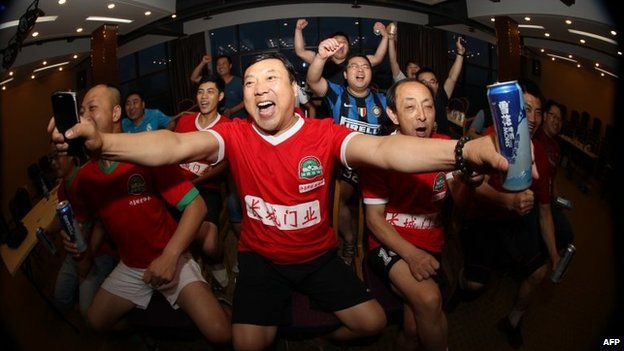 """Chinese football fans react as they watch the opening football match between Brazil and Croatia of the 2014 World Cup, in Xuchang, north China""""s Henan province on June 13"""